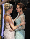 The Artist stars Penelope Ann Miller and Bérénice Bejo celebrate their best picture win onstage.