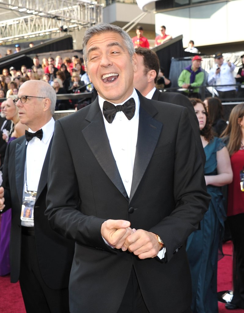 George gets giddy on the red carpet
