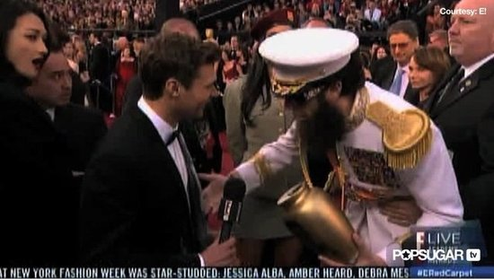 Video: Watch Sacha Baron Cohen's Dictator Spill Ashes on Ryan Seacrest!