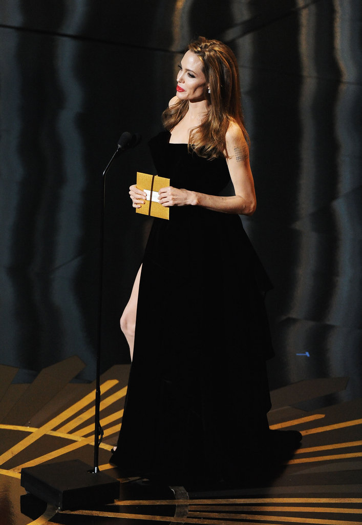 Angelina Jolie took the stage in a sexy dress.
