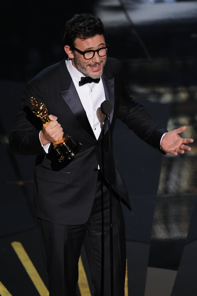 Michel Hazanavicius accepts an award onstage at the 2012 Oscars.