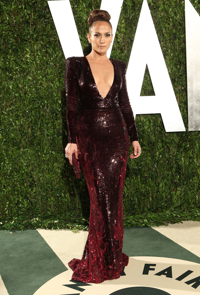 Jennifer Lopez slipped into her second outfit of Oscars night, and it was equally sexy. The dark crimson Zuhair Murad sequined gown showed off a daring amount of decolletage, but in true J Lo fashion, its slinkiness worked for her.