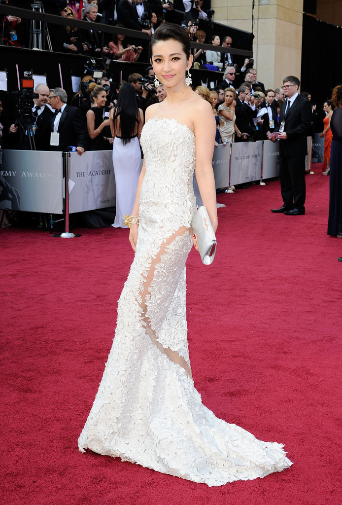 Director Li Bingbing stunned in white Georges Chakra Couture gown featuring sexy sheer detailing.