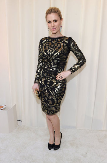 Anna Paquin covered up in a Pucci long-sleeved black dress finished in embellished details. Her gold jewels and black pumps topped off the cocktail-party look.