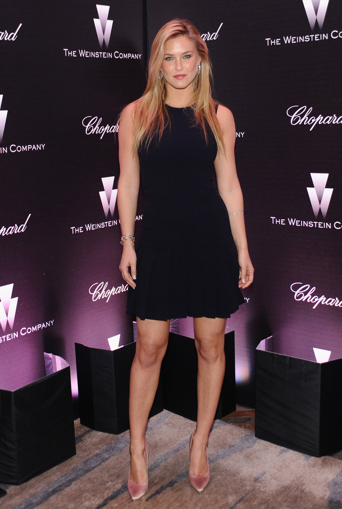 Bar Refaeli went sexy in a short black cocktail dress and nude pumps.