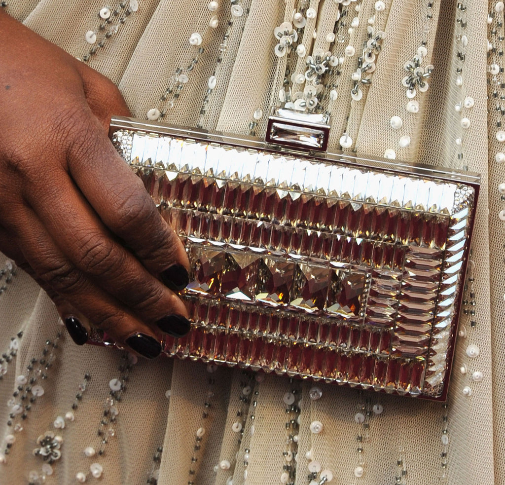 The metallic finish on Octavia's clutch highlighted her gown's glittering sequins.