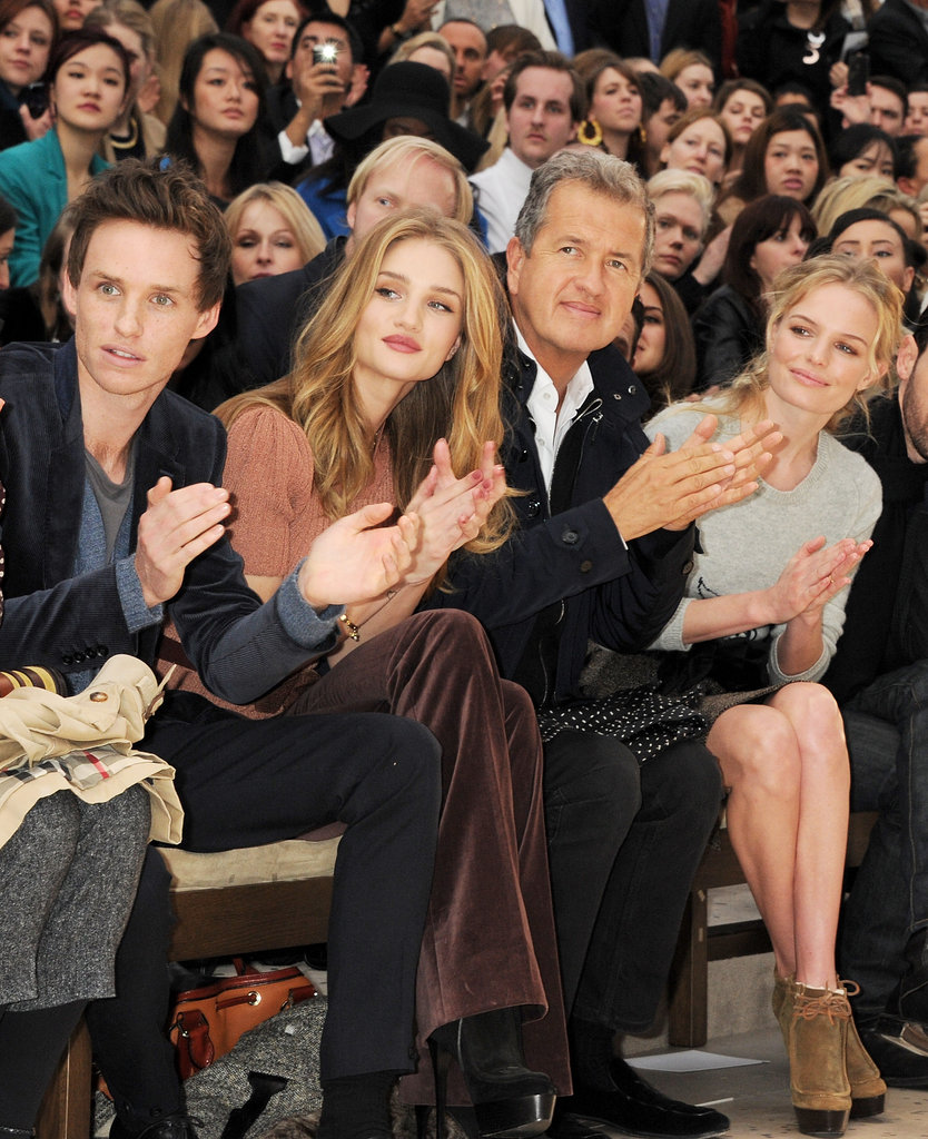 Eddie Redmayne, Rosie Huntington-Whiteley, and Kate Bosworth applaud at the Burberry Runway during New York Fashion Week.