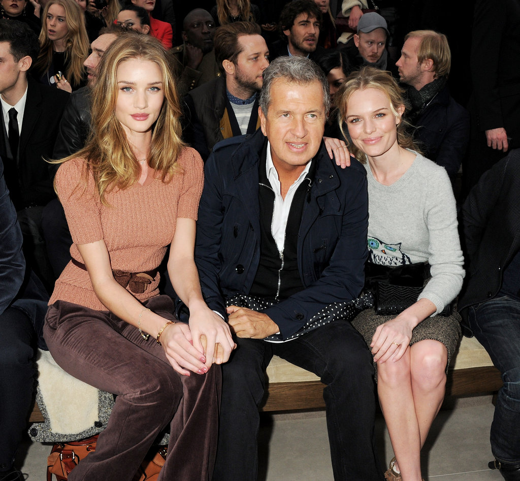Rosie Huntington-Whiteley, Mario Testino, and Kate Bosworth take a moment to pose for a photo while attending the Fall 2012 Burberry show.
