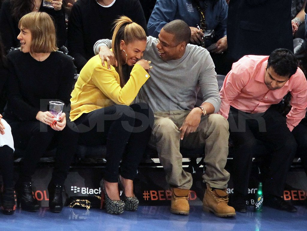 Beyoncé and Jay shared a laugh on the sidelines.