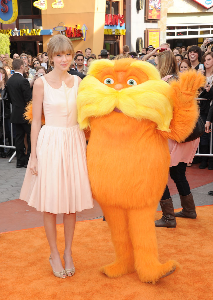 Taylor Swift and the Lorax had their photo taken by fans at the premiere of The Lorax.