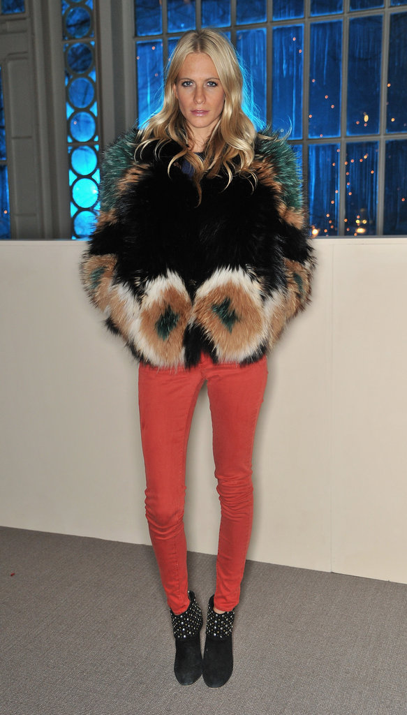 Poppy Delevigne paired a statement fur coat with colored denim at the Matthew Williamson runway show.