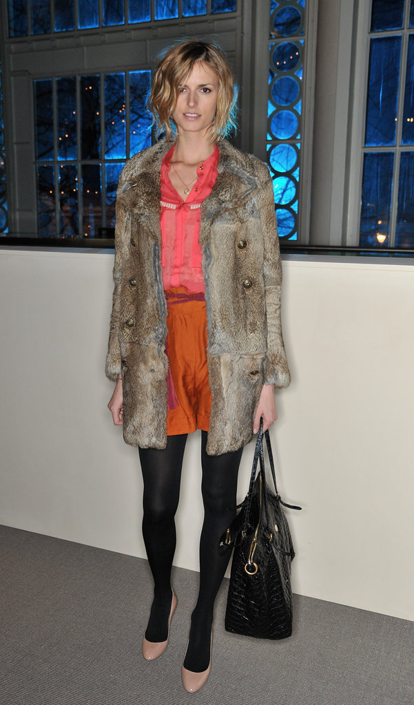 Jacquetta Wheeler layered her colorful shorts and blouse with tights and a fur jacket at the Matthew Williamson runway show.