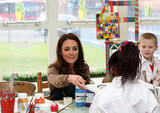 Kate Middleton helped a child with her painting.