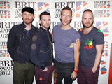 The guys of Coldplay, Jonny Buckland, Guy Berryman, Chris Martin and Will Champion, posed together.