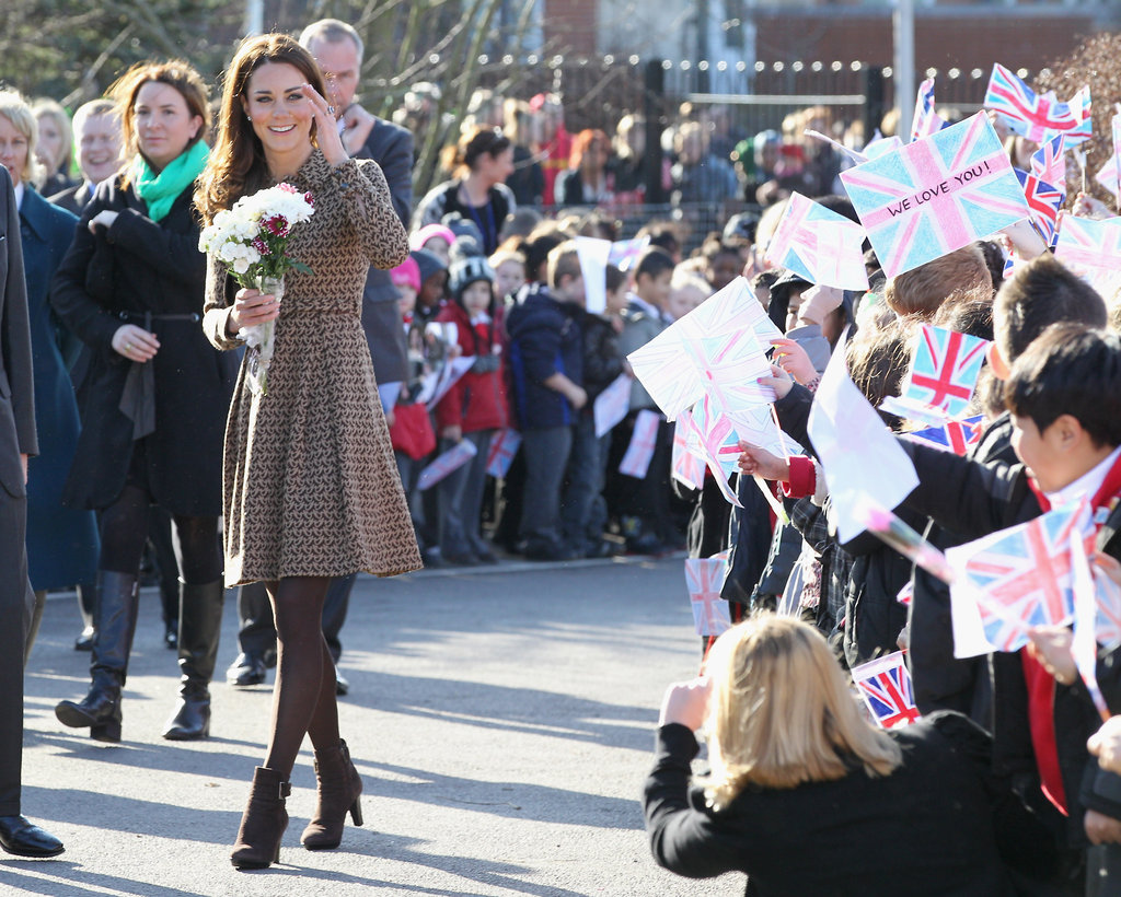 Kate Middleton wore brown Orla Kiely to a school.