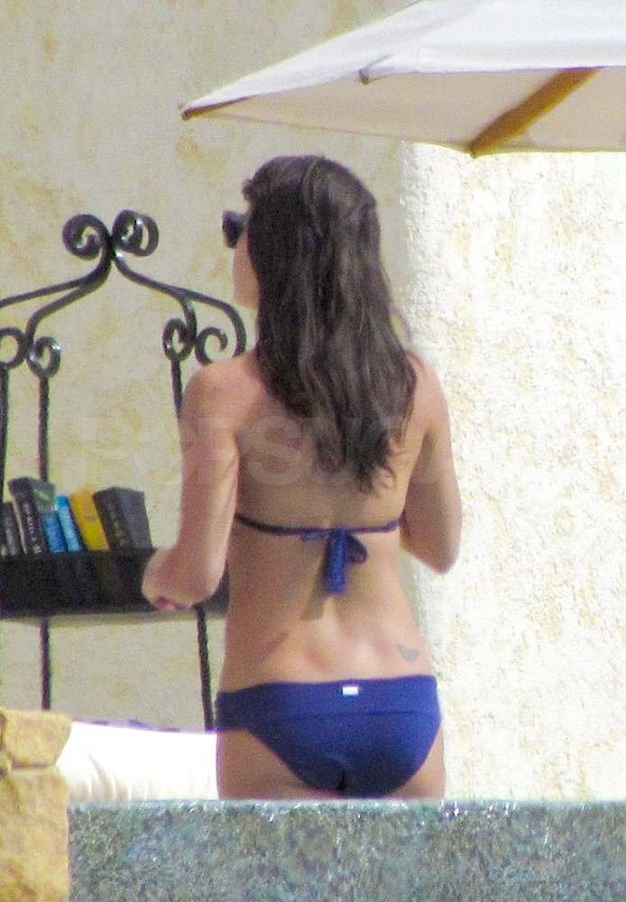 Lea Michele wearing a blue bikini.
