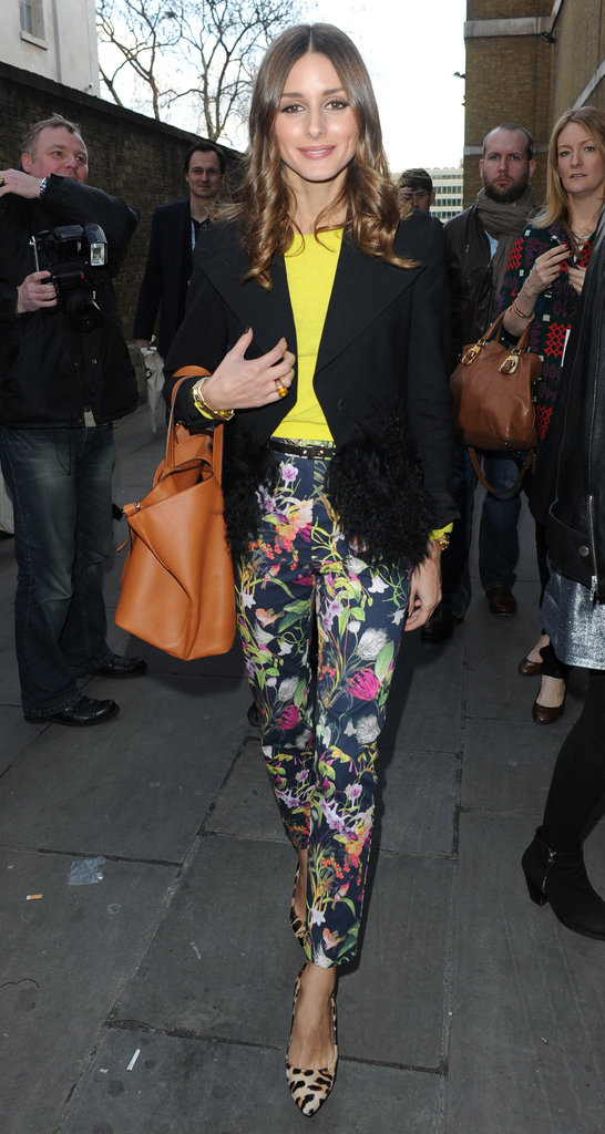 Olivia Palermo paired her Topshop floral pants with a neon sweater and black blazer at London Fashion Week.    More Topshop...