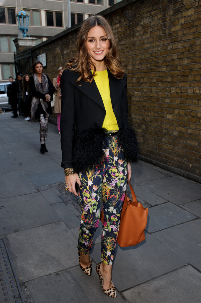 Olivia plays to fashion whimsy in Topshop floral pants, a citrus-hued tee and a pair of leopard print Mulberry heels while attending the Unique show at London Fashion Week.  4761884