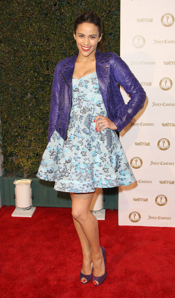 Paula Patton paired a flirty floral dress with a purple moto jacket.