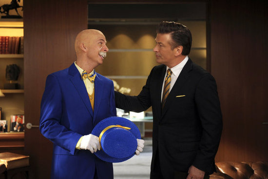 Jack McBrayer as Kenneth Parcell and Alec Baldwin as Jack Donaghy on 30 Rock.