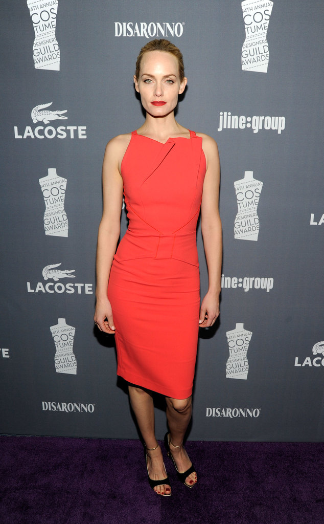 Amber Valletta wore a red dress.