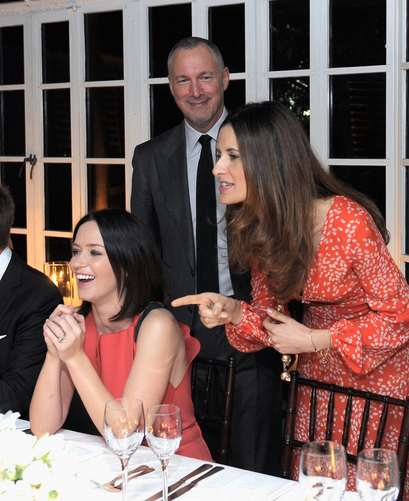 Livia Firth laughed with Emily Blunt and Vanity Fair publisher Edward Menicheschi.