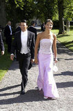 Way back in 2003, Crown Princess Victoria and then-boyfriend Daniel attend a friend's wedding.