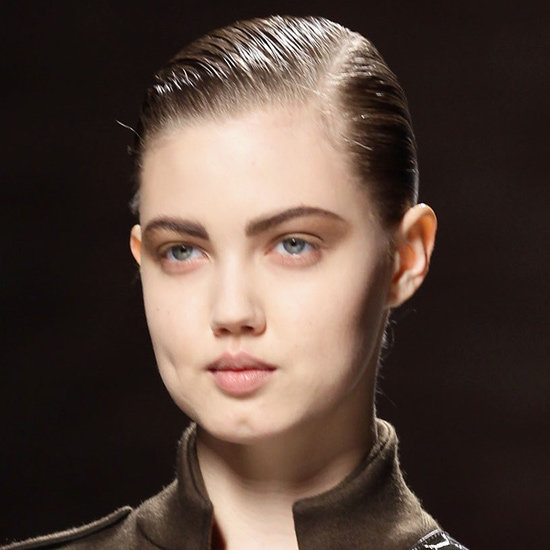 Lead hairstylist Luigi Murenu (John Frieda) slicked back models strands and parted them off centre.
