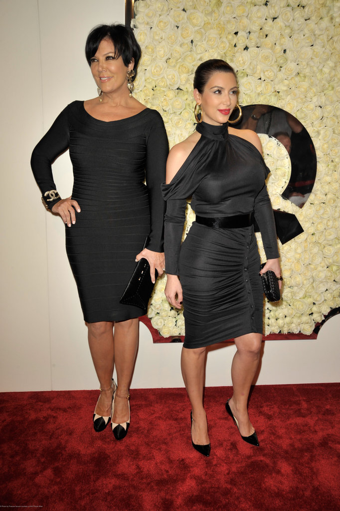 Kim Kardashian and her mom in black dresses.