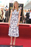 Jennifer Aniston ditched her LBDs and opted for a fresh printed Chanel at her Hollywood Walk of Fame tribute.