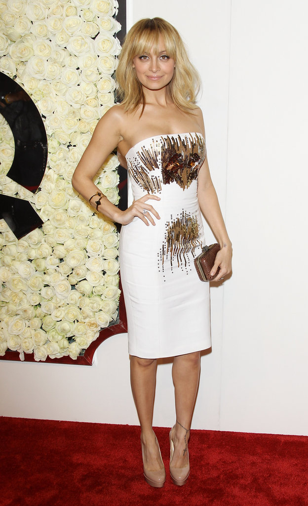 Nicole Richie showed off a body-con white strapless dress by Ungaro with nude pumps at QVC's Buzz on the Red Carpet party. Check out Nicole's new line for QVC, highlighting her cool bohemian style.