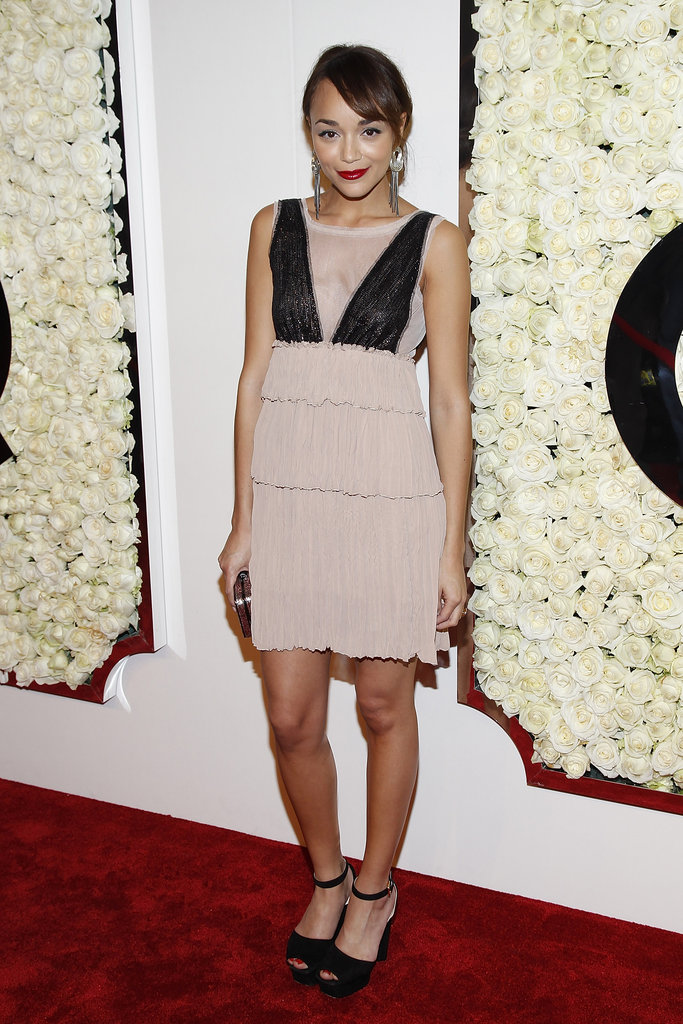 Revenge start Ashley Madekwe attended QVC's Buzz on the Red Carpet party in a feminine tiered dress and ankle-strap pumps. Love her style? Check out her complete style profile right now.