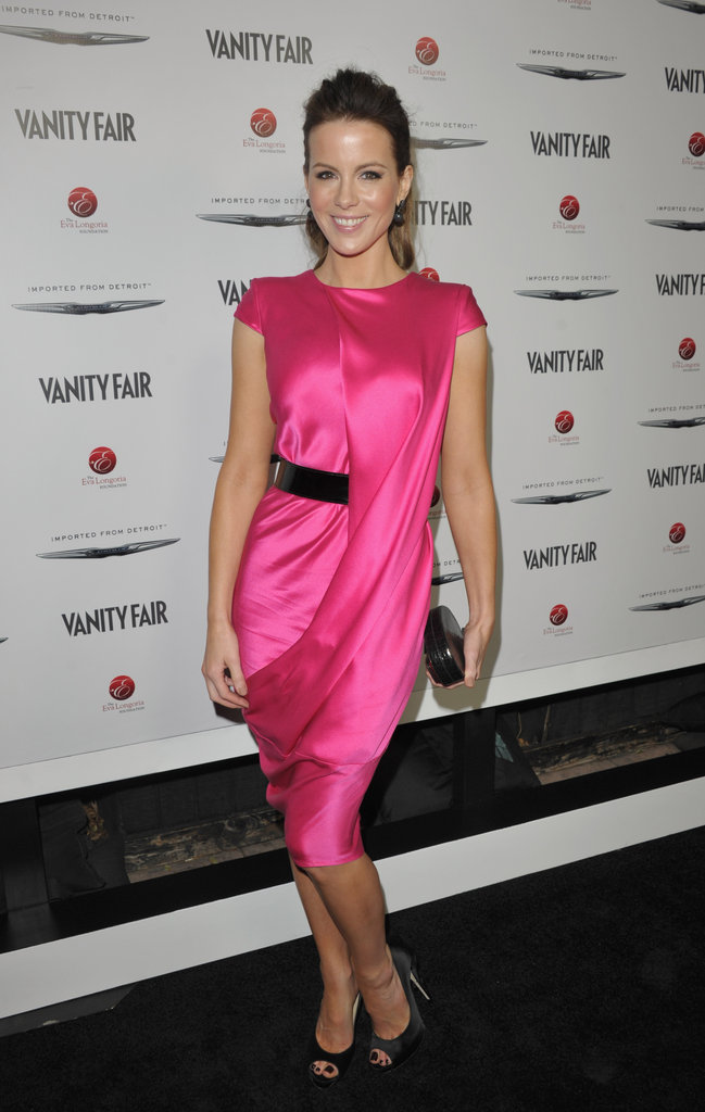 Kate Beckinsale donned a hot pink Alexander McQueen dress with black peep-toe pumps at the Vanity Fair and Chrysler cohosted bash in LA. Here are some easy ways to add a neon pop to your wardrobe now.