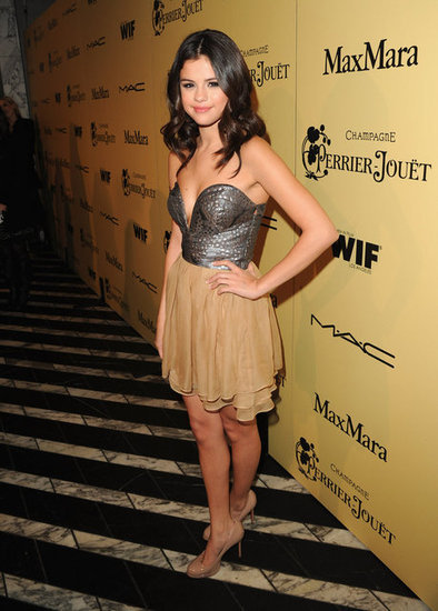 Selena worked a beautiful metallic and nude combination in her  Ani Lee dress ($324) and Louboutin pumps. Love the dress? You can buy it for your next cocktail party!