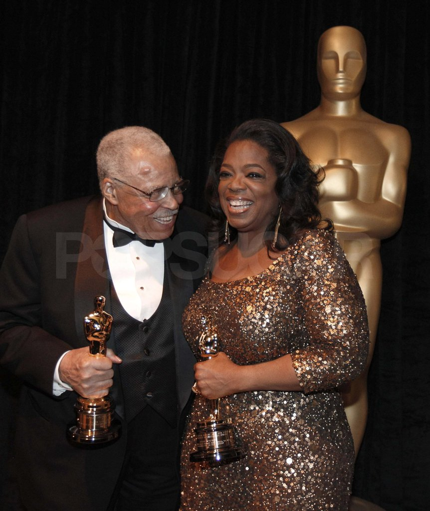 Oprah Winfrey and James Earl Jones posed with Oscars backstage.