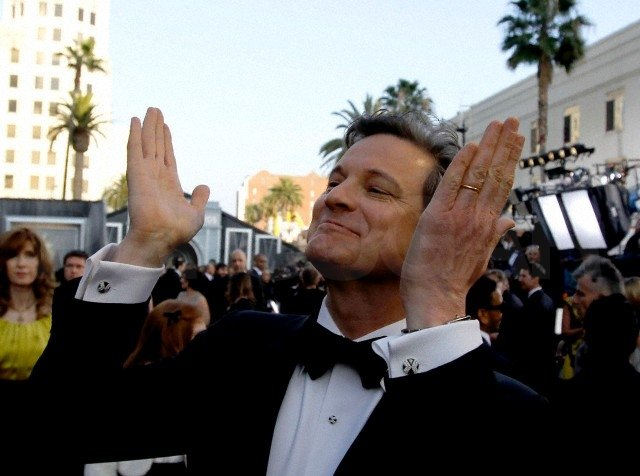 Last year's best actor winner for The King's Speech, Colin Firth, showed love to the crowd.