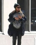 Beyoncé Knowles stayed warm in a beanie as she carried Blue Ivy Carter.
