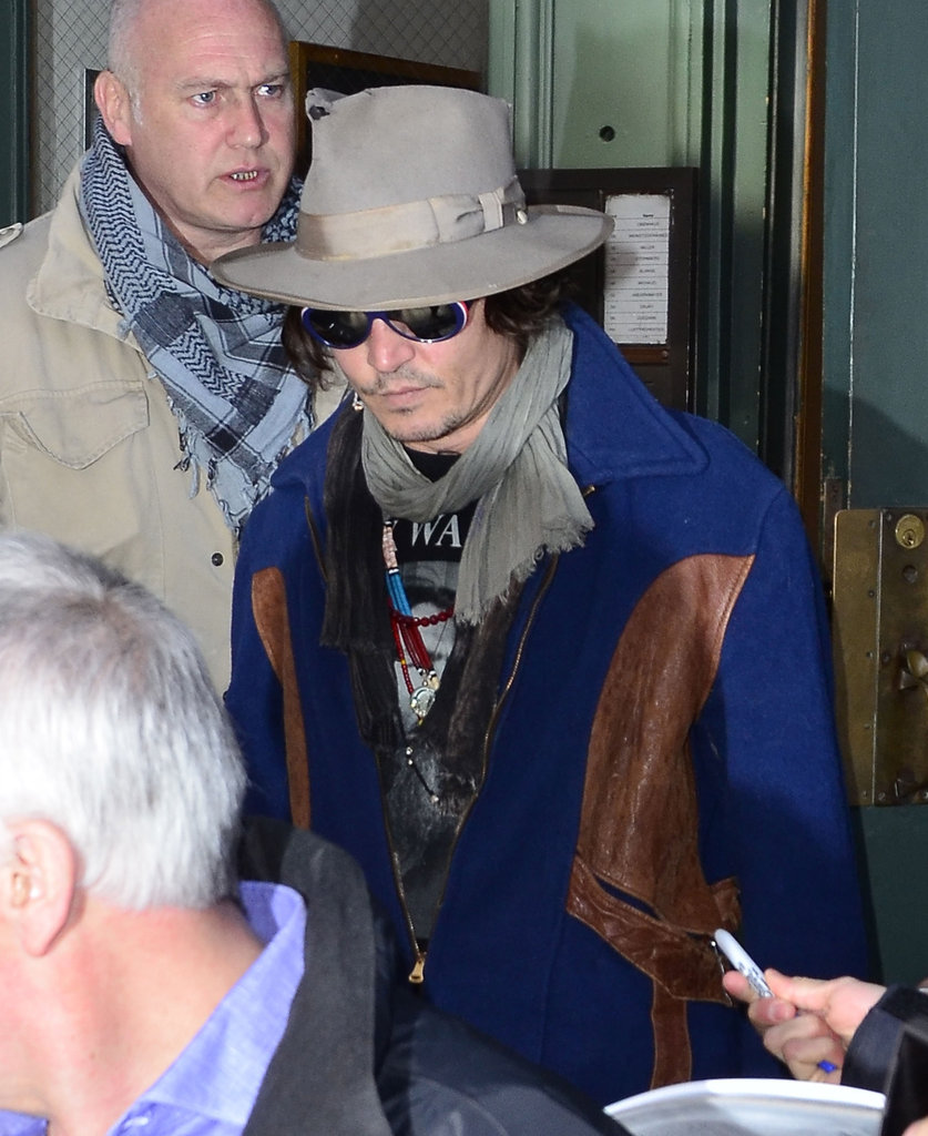 Johnny Depp wore a hat and scarf in NYC.