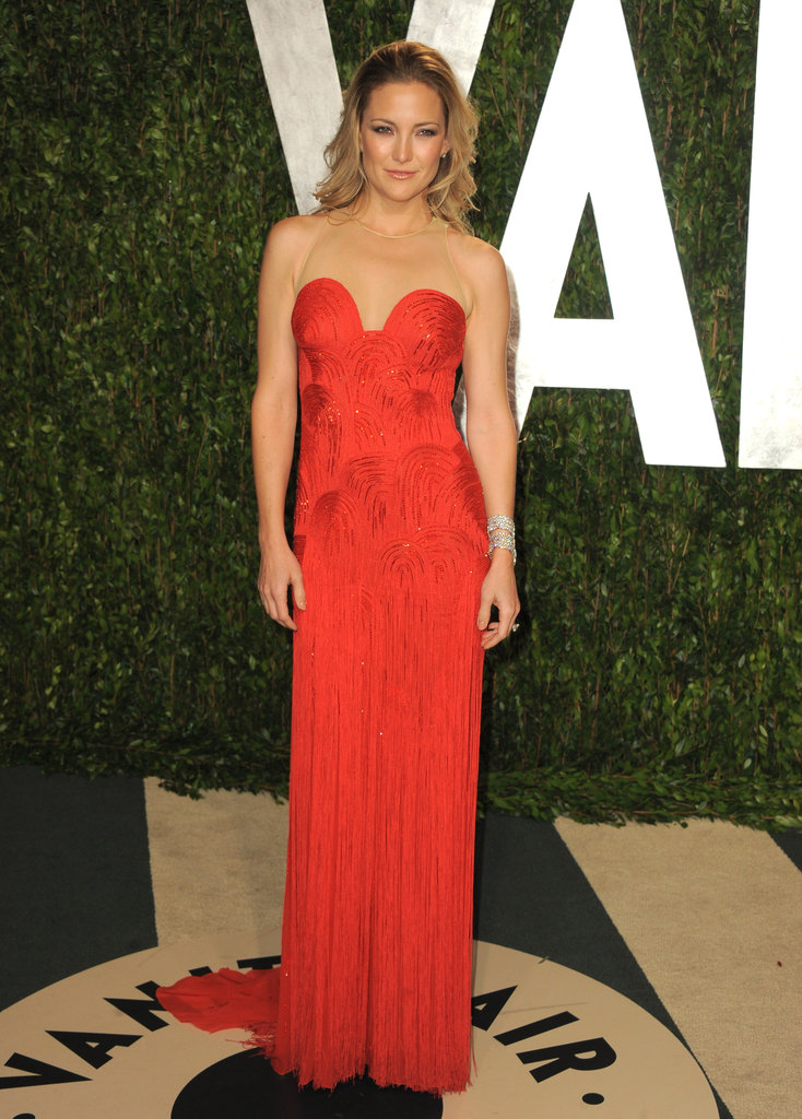 Kate Hudson looked red-hot in a vintage Versace gown at the Vanity Fair Oscar party.