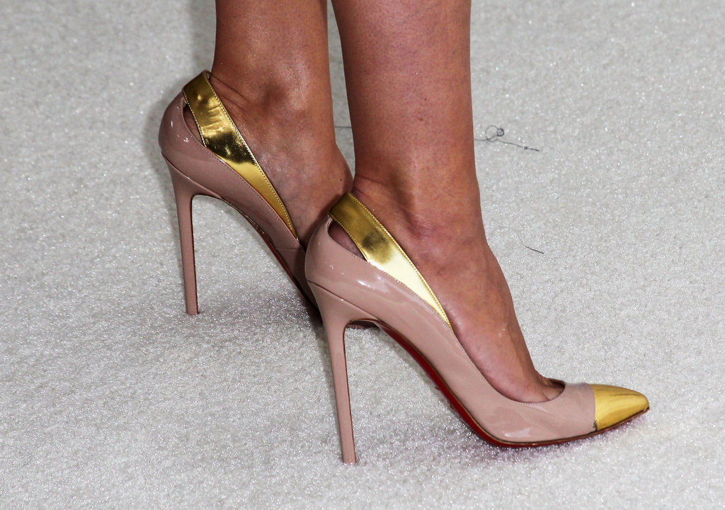 Heidi Klum added these statement-making Christian Louboutin cap-toe pumps to her daring little Versace mini.