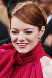 Emma Stone added a pair of enchanting Louis Vuitton earrings in the same brilliant hue as her Giambattista Valli gown.