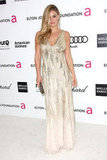 Bar Refaeli showed off her curves in a gold sequined Roberto Cavalli gown.