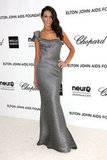 Terri Seymour chose a one-shouldered gown in gray metallic.