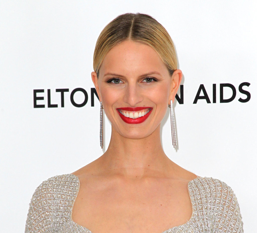 Embrace the statement power of Karolina Kurkova's earrings with a dangling rhinestone-studded pair. 4801678