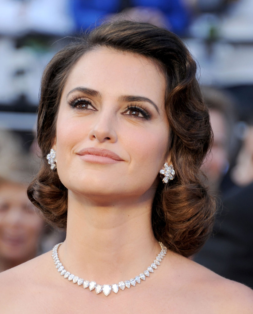 Pretty flower-shaped studs like Penelope Cruz's add sweetness and sparkle.  4801768