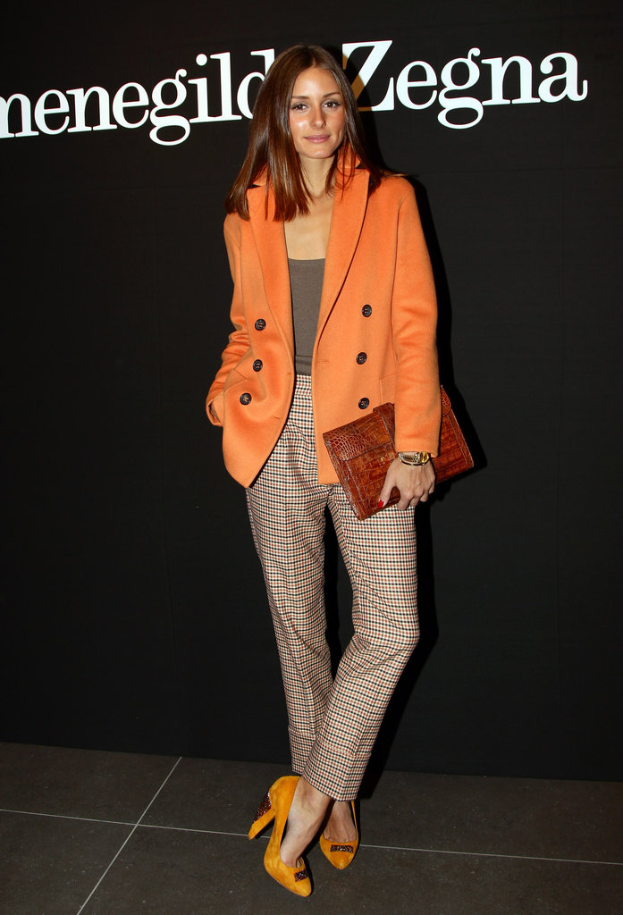 Olivia looks great in orange, and she wears the color often. Here she played around with menswear pieces, like plaid trousers, and kept them feminine via bright pieces.  Casual Pants by Forever 21Pumps by Nine West