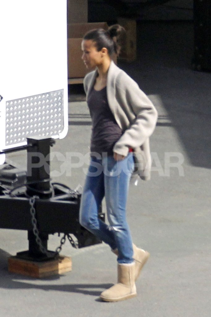 Zoe Saldana arrived on set in Ugg boots and distressed jeans.