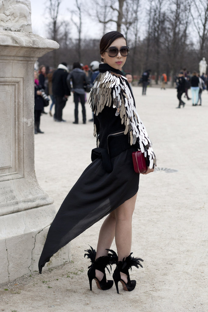 Fashion-forward details from her coat to her heels.