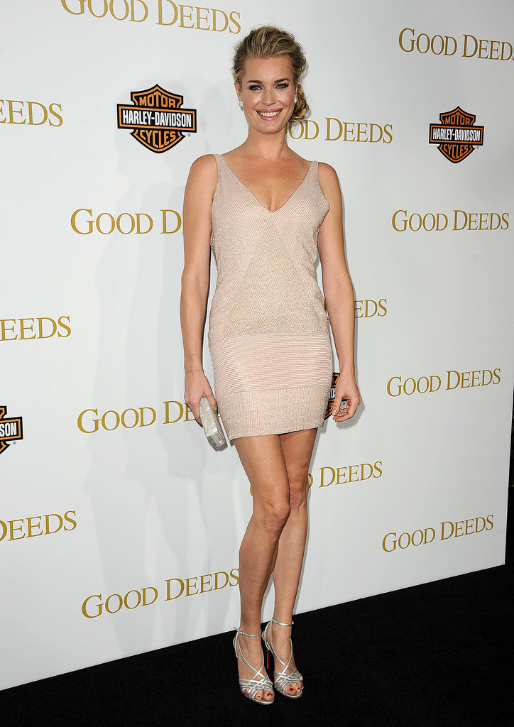 Rebecca Romijn's strappy sandals up the ante on her sexy little dress.
