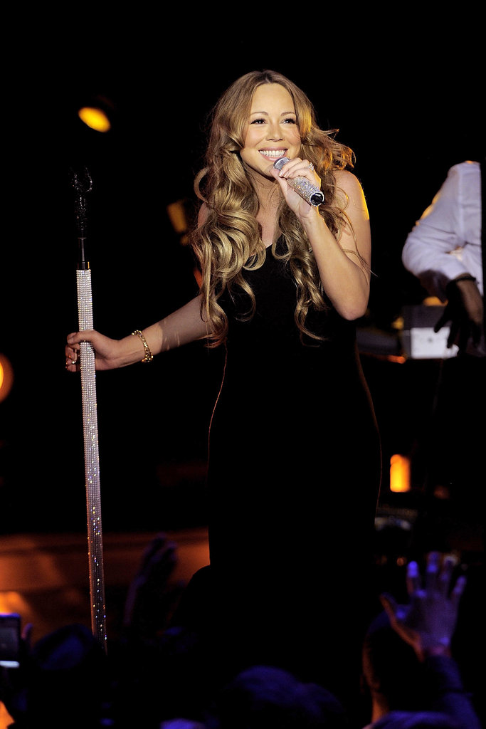 Mariah Carey smiled on stage.
